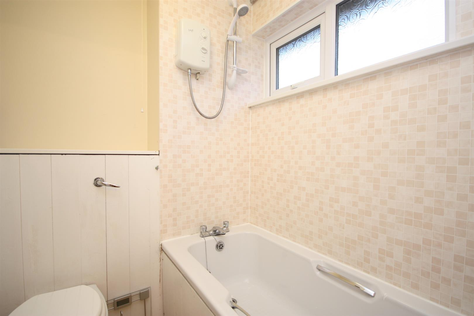 walesby court leeds hardisty and co fitted with a white bath and wc electric shower over the bath and electric wall heater modern wood effect flooring and upvc double glazed window to the